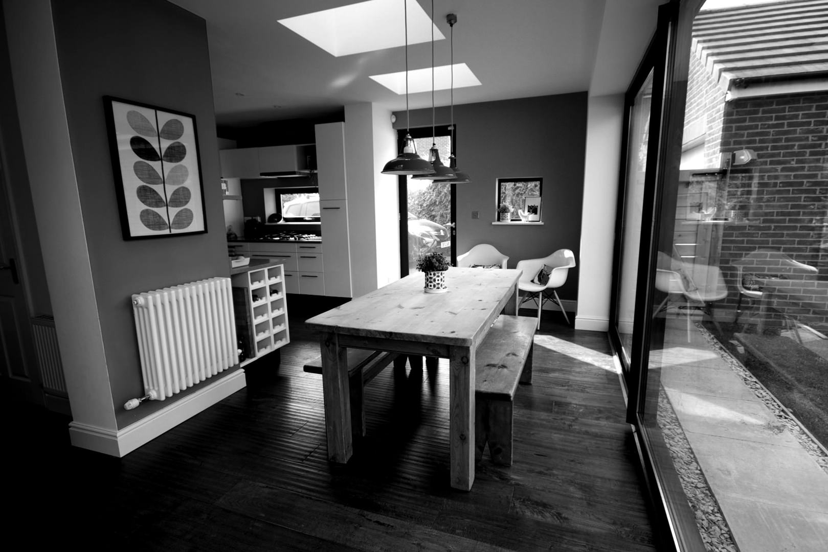 A single storey rear extension to create a new open plan kitchen/dining/living space addition to a 5 bedroom new estate house in south Liverpool