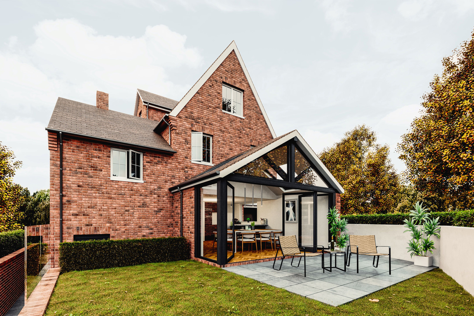 Single-storey rear extension and loft conversion in a Bedfordshire woodland setting created a new 'inside-outside' space and an extra entertaining room clad with black stained weather boarding