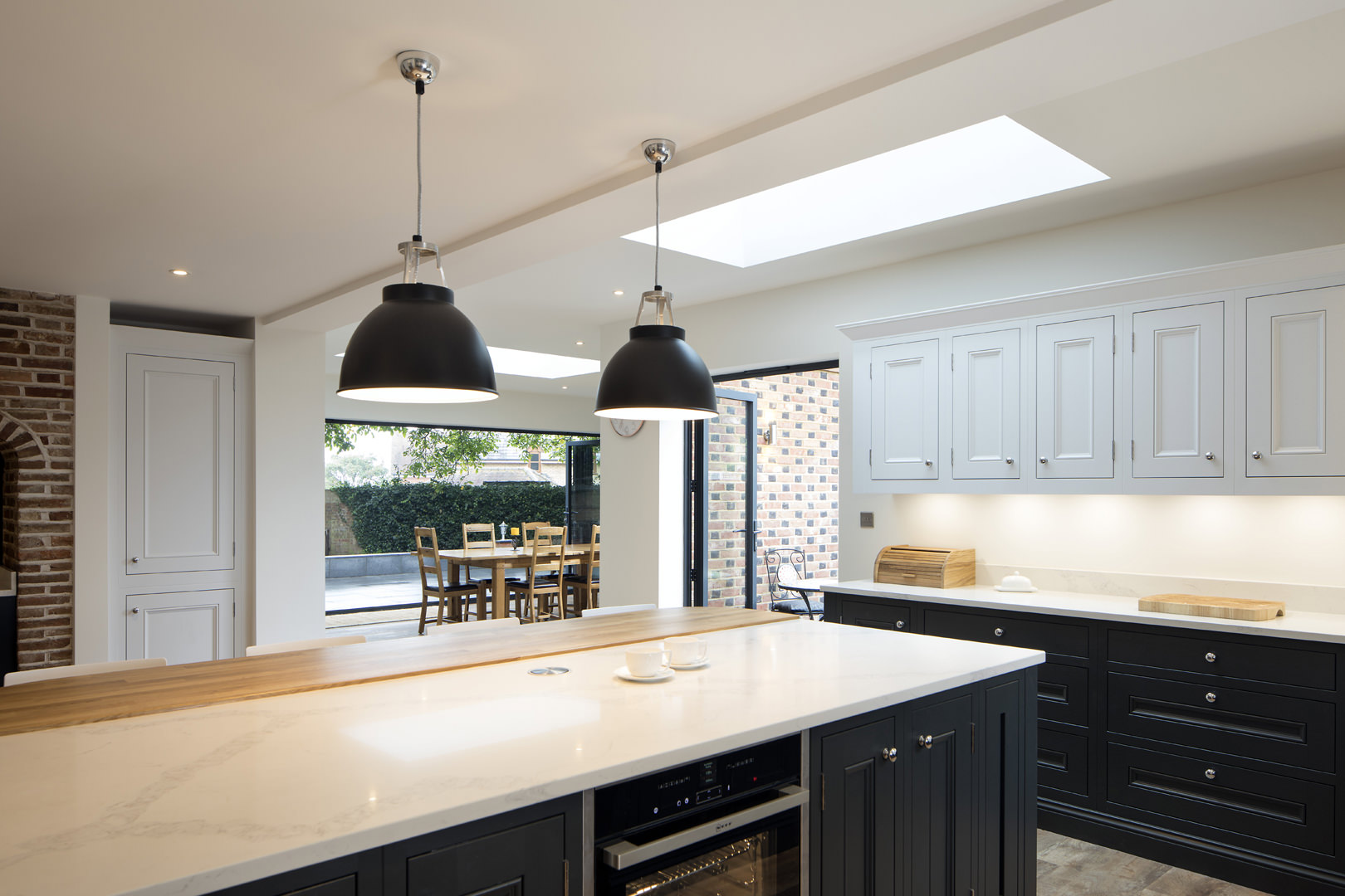 A brick detailed single storey extension to this beautiful house on the edge of a conservation area in central Bedfordshire opened the kitchen and dining space up to the garden and natural light floods in through roof lantern lights